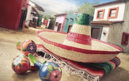 """Mexican hat """"sombrero"""" on a """"serape"""" in a mexican town"""